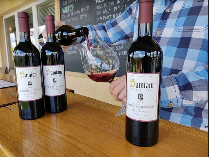 Cabernet being poured into a glass.